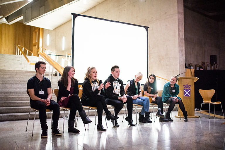 Young people taking questions from the audience at an event at the Scottish Parliament on their ideas about preventing sexual violence